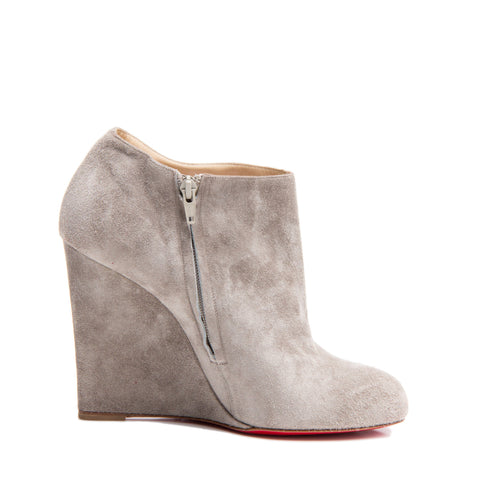 Find an authentic preowned Christian Louboutin Grey Suede Ankle Boot Wedges, size 41.5 (Italian) at BunnyJack.