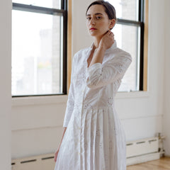 Find an authentic preowned Prada White Cotton Eyelet Shirtdress size 44 (Italian) at BunnyJack, where up to 50% of each sale price is donated to charity.