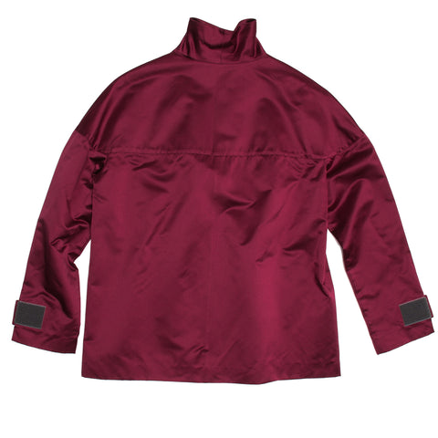 Find an authentic preowned Prada Bordeaux Silk Tunic Top size 44 (Italian) at BunnyJack, where up to 50% of each sale price is donated to charity.