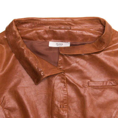 Find an authentic preowned Prada Brown Leather Cropped Jacket size 44 (Italian) at BunnyJack, where up to 50% of each sale price is donated to charity.