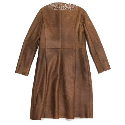 Find an authentic preowned Prada Brown Shearling & Fur Coat, size 46 (Italian) at BunnyJack, where up to 50% of each sale price is donated to charity.