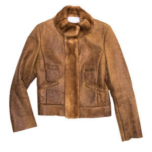 Find an authentic preowned Prada Brown Shearling & Fur Jacket, size 44 (Italian) at BunnyJack, where up to 50% of each sale price is donated to charity.