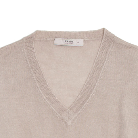 Find an authentic preowned Prada Taupe Fitted V-Neck Pullover size 44 (Italian) at BunnyJack, where up to 50% of each sale price is donated to charity.