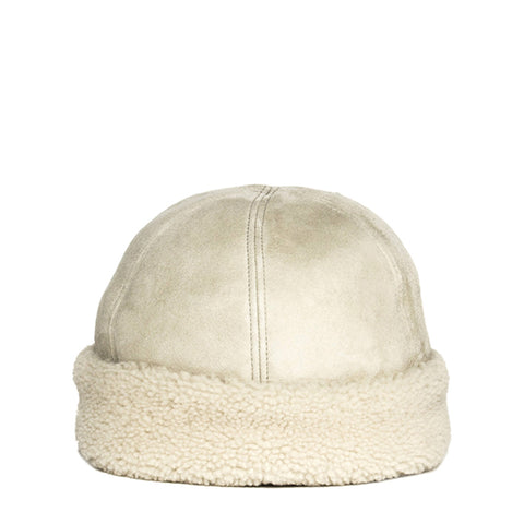 Find an authentic preowned Prada Ivory Suede & Shearling Cap size Large at BunnyJack, where up to 50% of each sale price is donated to charity.