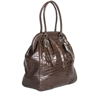 Find an authentic preowned Prada Brown Crocodile Vintage Style Bag at BunnyJack, where up to 50% of each sale price is donated to charity.