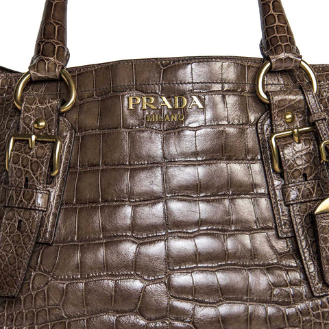 Find an authentic preowned Prada Brown Crocodile Large Bag at BunnyJack, where up to 50% of each sale price is donated to charity.