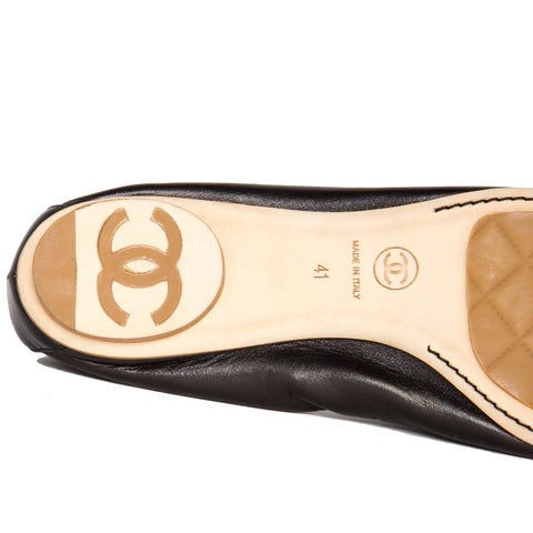 Find an authentic pair of preowned Chanel Black Leather Ballerina Shoes, size 41 (Italian) at BunnyJack, where a portion of every sale goes to charity.