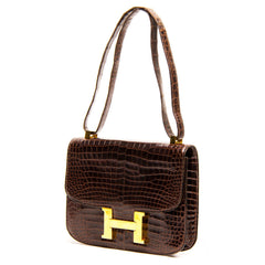 Find an authentic preowned Hermès Brown Crocodile Constance 23cm Bag at BunnyJack, where a portion of every sale goes to charity.