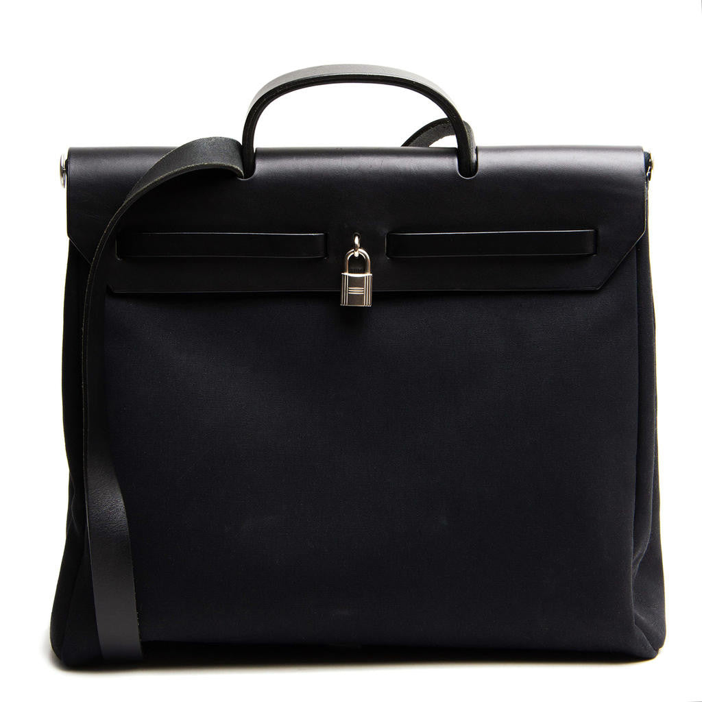 Find an authentic preowned Hermès Black Canvas 2 in 1 Herbag at BunnyJack, where a portion of every sale goes to charity.