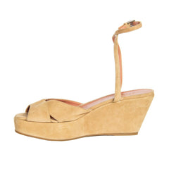 Find authentic preowned Azzedine Preloved Alaia Tan Suede Wedge Sandals size 40.5 (Italian) at BunnyJack, where a portion of every sale goes to charity.