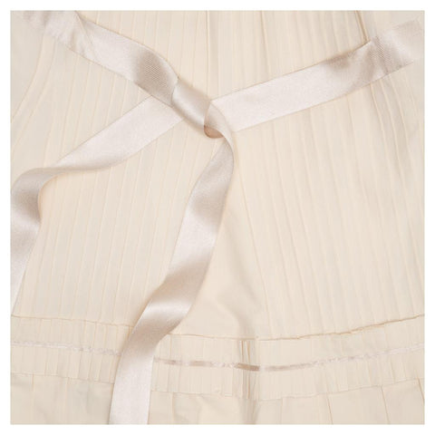 Find an authentic preowned Prada Ivory Cotton Pleated Dress size 46 (Italian) at BunnyJack, where up to 50% of each sale price is donated to charity.