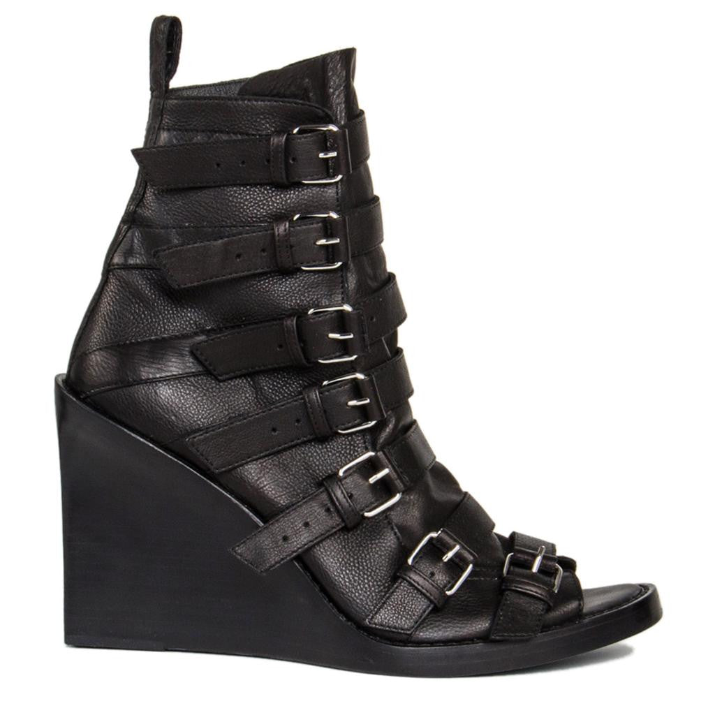 .Find an authentic preowned Ann Demeulemeester Black Open Front Ankle Boots, size 40 (Italian) at BunnyJack.