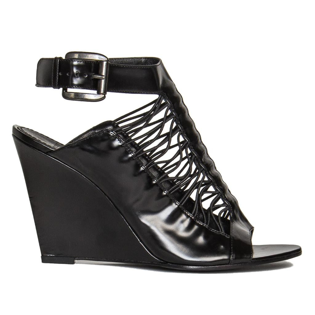 Find an authentic pair of preowned Givenchy Black Wedge Sandals, size 40.5 (Italian) at BunnyJack, where a portion of every sale goes to charity.