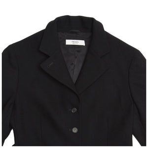 Find an authentic preowned Prada Black Wool Riding Style Coat size 44 (Italian) at BunnyJack, where up to 50% of each sale price is donated to charity.