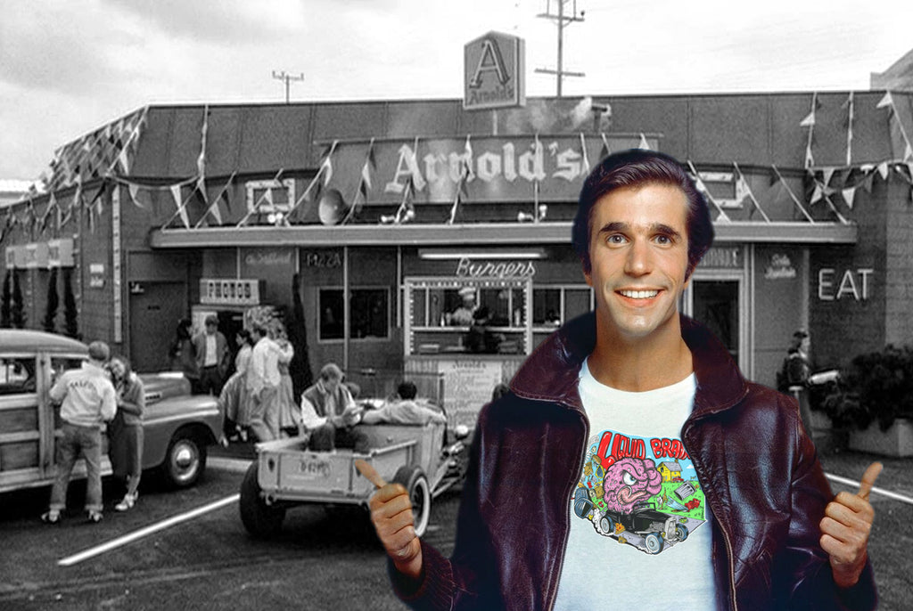 Fonzie wearing a Liquid Brains Hot Rod Tee in front of a Black and White Arnolds