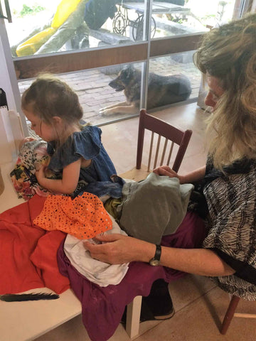 sewing with Granddaughter
