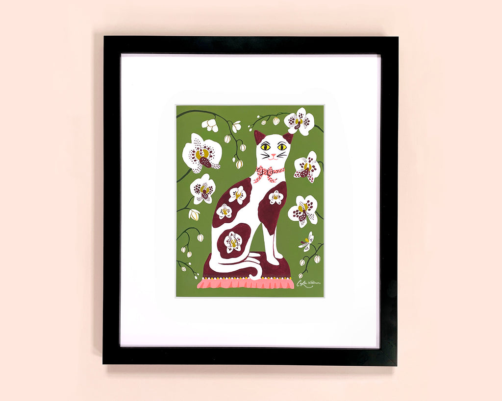 Framed art print of a calico cat with orchid flowers by Colee Wilkinson