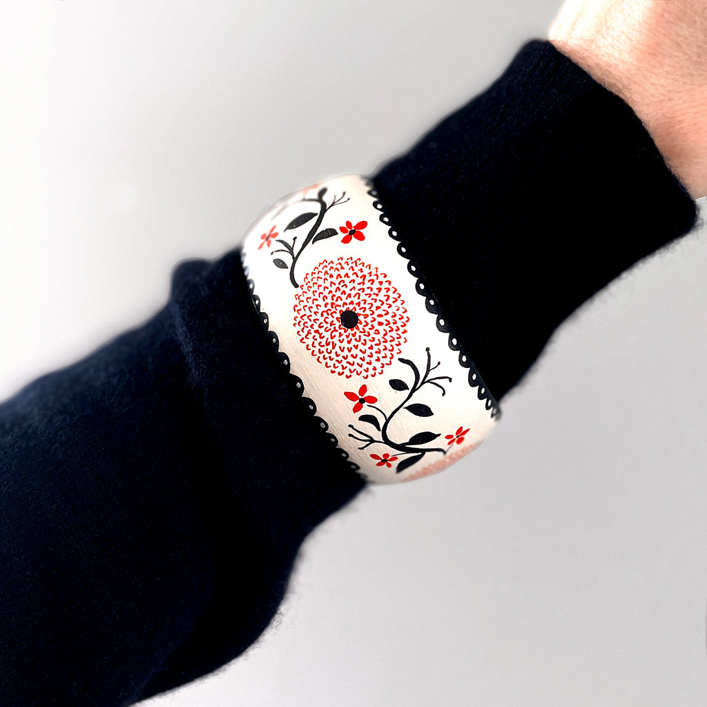 Hand painted wooden bangle bracelet with red zinnia flowers by Colee Wilkinson