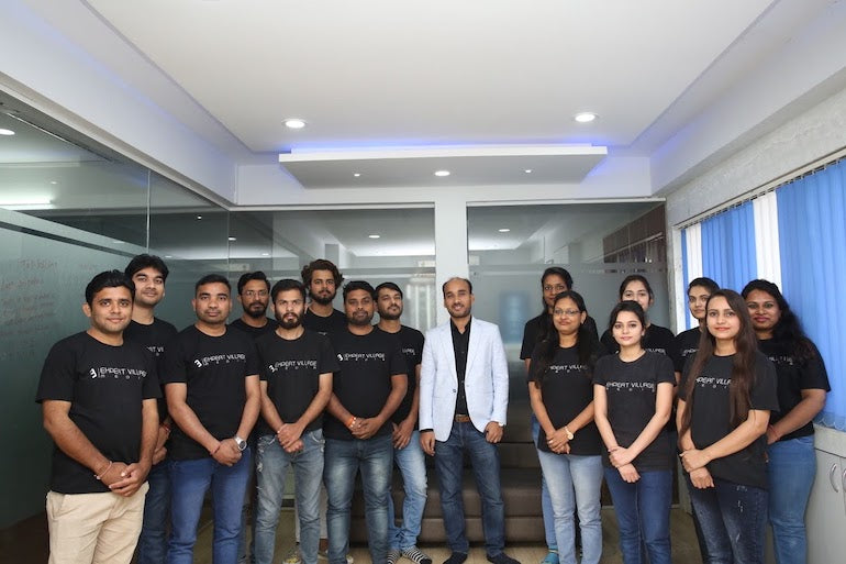 App performance: Photo of the 16 team members behind Shopify app Wiser. In this photo, eight men are on the left, seven women are on the right, and the founder, Amit Porwal, stands in the center wearing a white blazer while the rest of the team is wearing black t-shirts.
