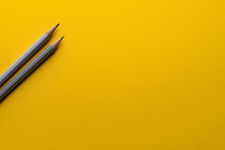 design brief: 2 pencils on a yellow background