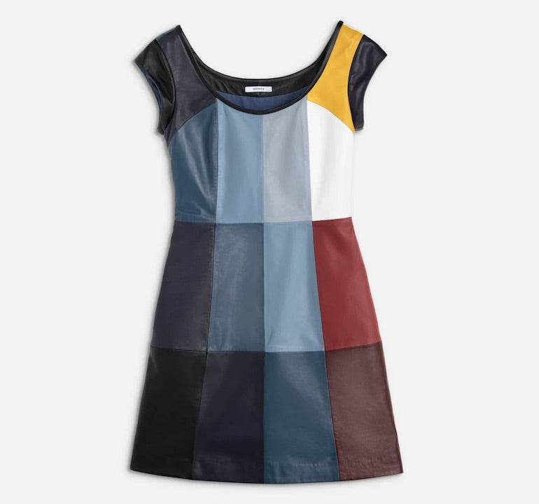 Leather dress with thin, rounded black collar in front and back, short black sleeves. Dress pattern is made up of colored and symmetrical vertical rectangles. Colors include mostly various shades of blue with a small amount of yellow, white, red, maroon and grey. Waist tapers inward.