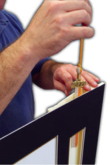 Install a graduation tassel to your diploma frame