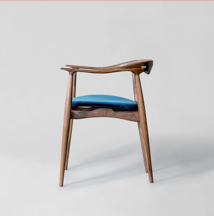 Walnut and velvet dining room chair by Mexico City Design Studio Atra. Represented by design gallery Tuleste Factory in New York City.