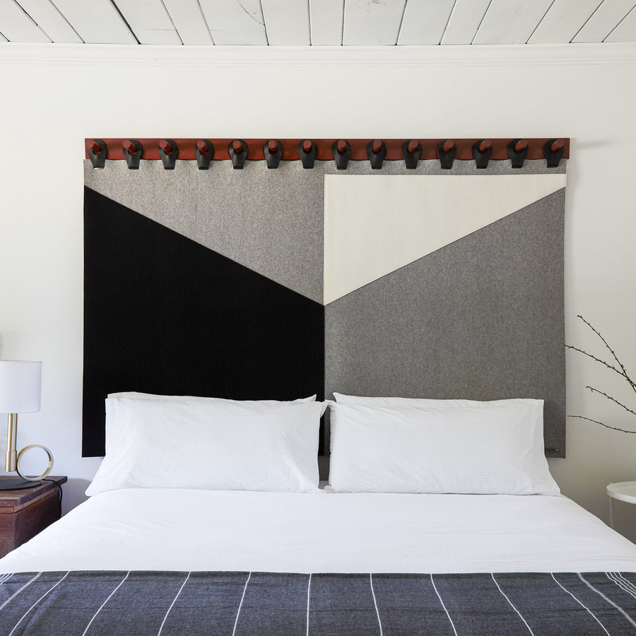 Luxury designer tapestry by Moses Nadel. Handcrafted from leather, and wool felt with wooden joinery. Represented by Tuleste Factory, a collectible design and fine art gallery in New York City.