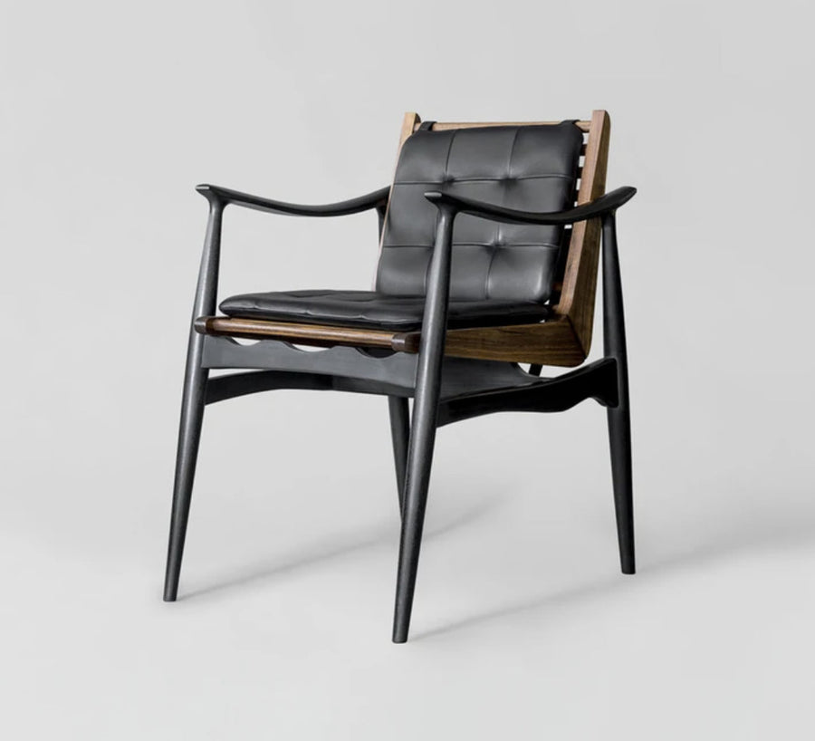 Brown and black wood design chair with leather cushion by furniture design studio, Atra. Represented by art gallery Tuleste Factory in New York City.