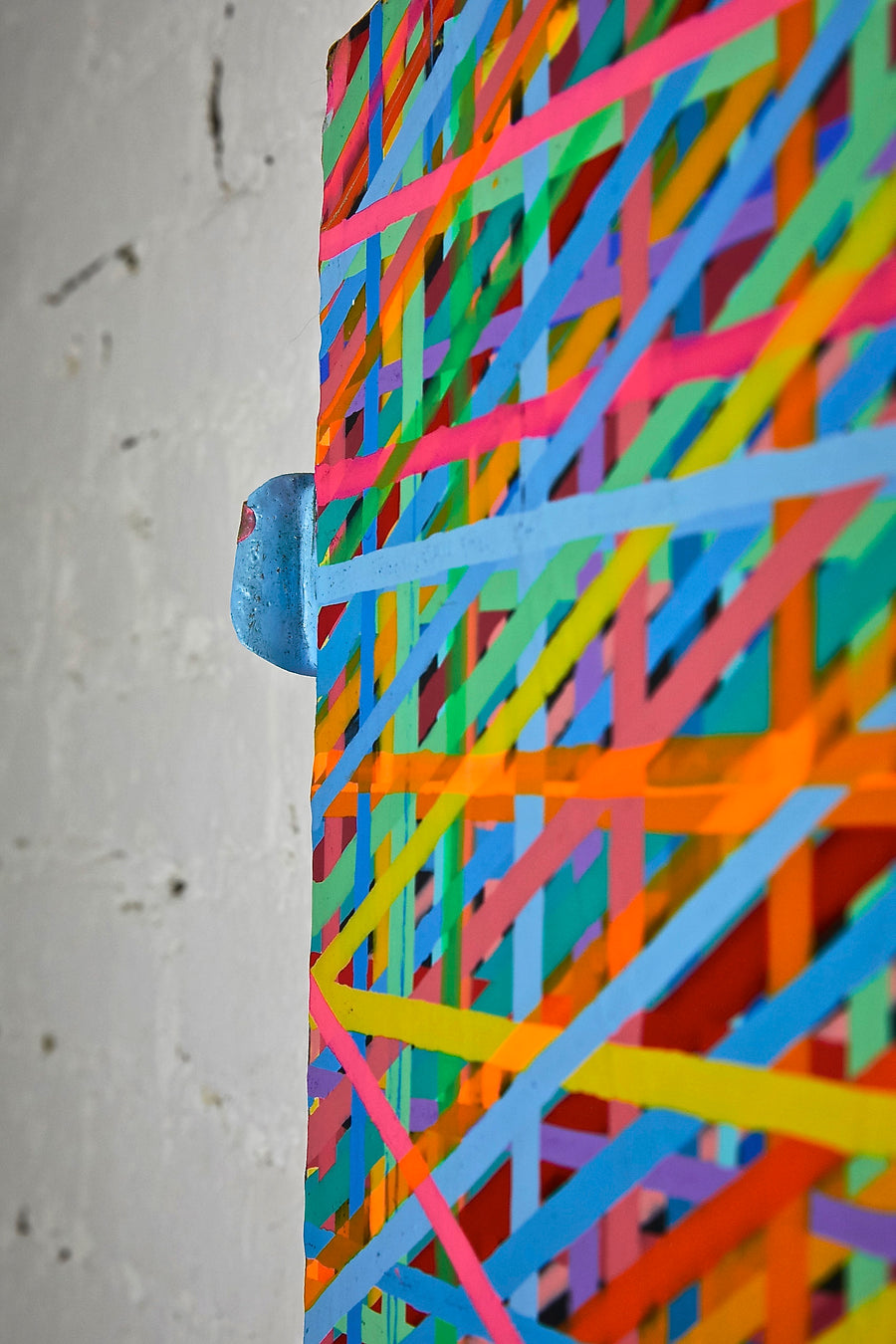 Detail shot of multicolor rainbow abstract drip painting by New York based artist Jon James. Represented by fine art gallery Tuleste Factory in Chelsea, NYC.
