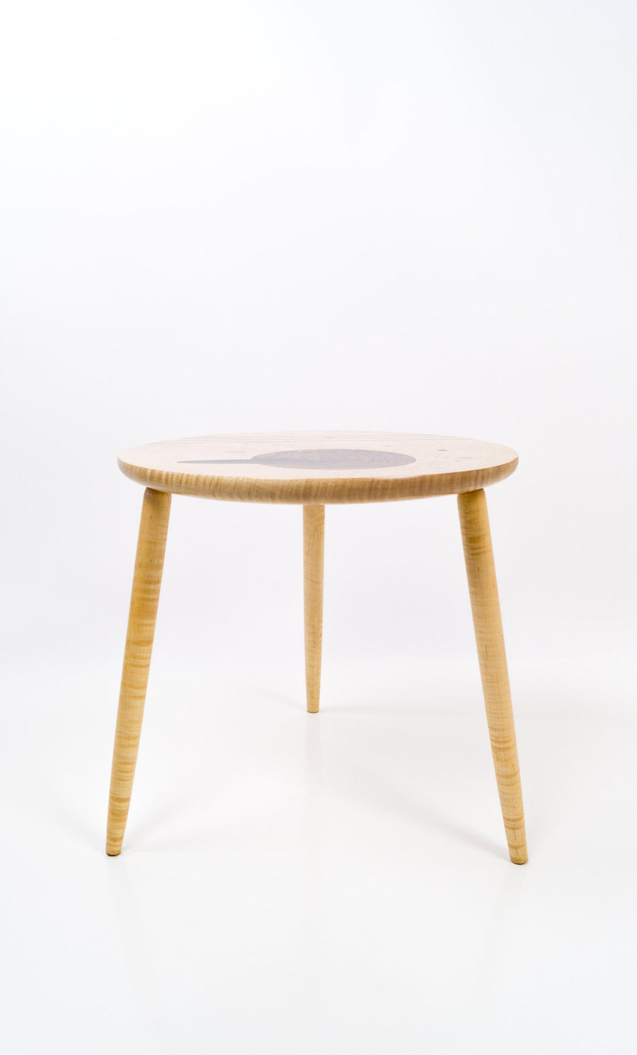 Artistic and unique designer side table in wood, inspired by mid-century modern design. Represented by creative space and gallery in New York City.