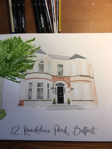 Hand lettering below a watercolour house painting in Belfast