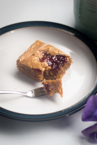 Fool proof white chocolate and raspberry blondie with a cup of tea