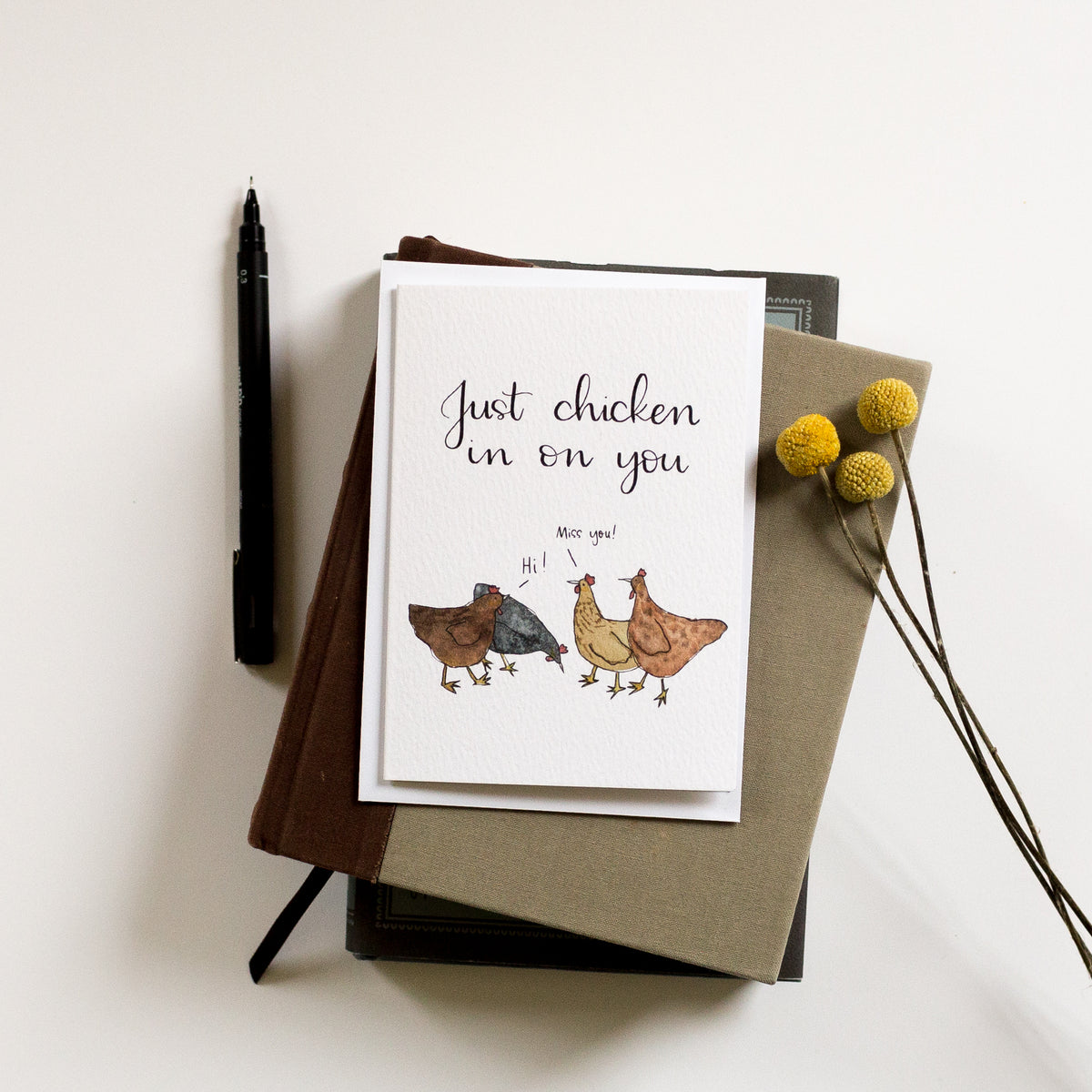 "Luxury card with hens on to tell someone you miss them. The ""just chicken in on you"" card has watercolour hens and a beautifully hand lettered pun. Fun and elegance in one!"