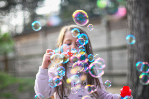 Blowing bubbles is a great outdoor activity for children