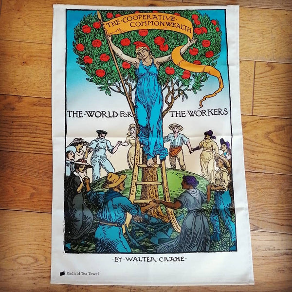 Co-operative Commonwealth tea towel, illustrated with workers surrounding figure holding banner | Image courtesy of People's History Museum shop
