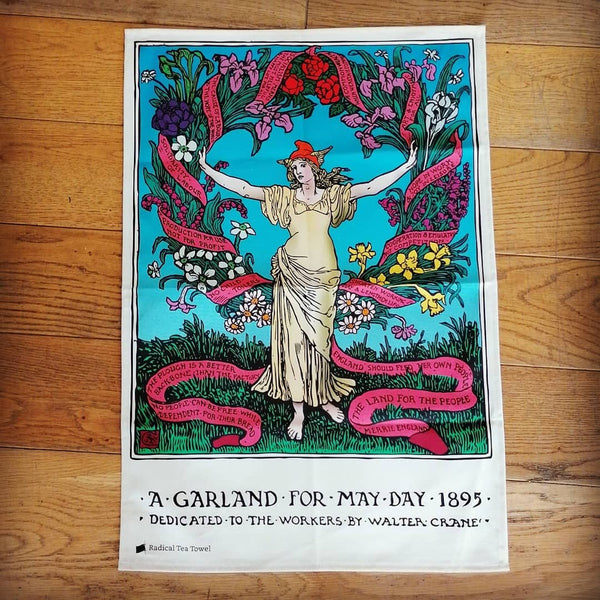 May Day tea towel, illustrated with a figure surrounded by a garland | Image courtesy of People's History Museum shop
