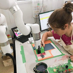 Joanne Hastie painting with robot arm