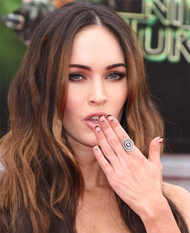 Megan Fox showing off a half-moon monochromatic manicure