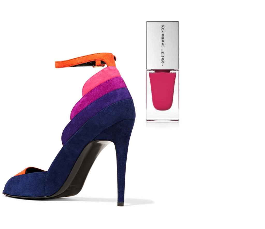 bright an sassy striped heels with a bright pink nail polish.