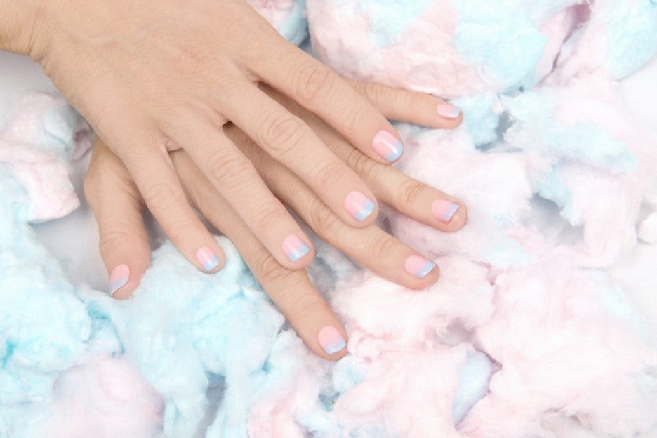 Pastel colored nail polish that looks like cotton candy.