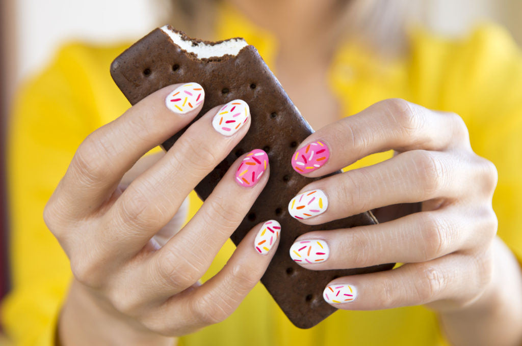Nails designed to look like sprinkles.