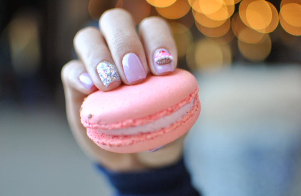 Pastel nail polish that matches a macaroon.