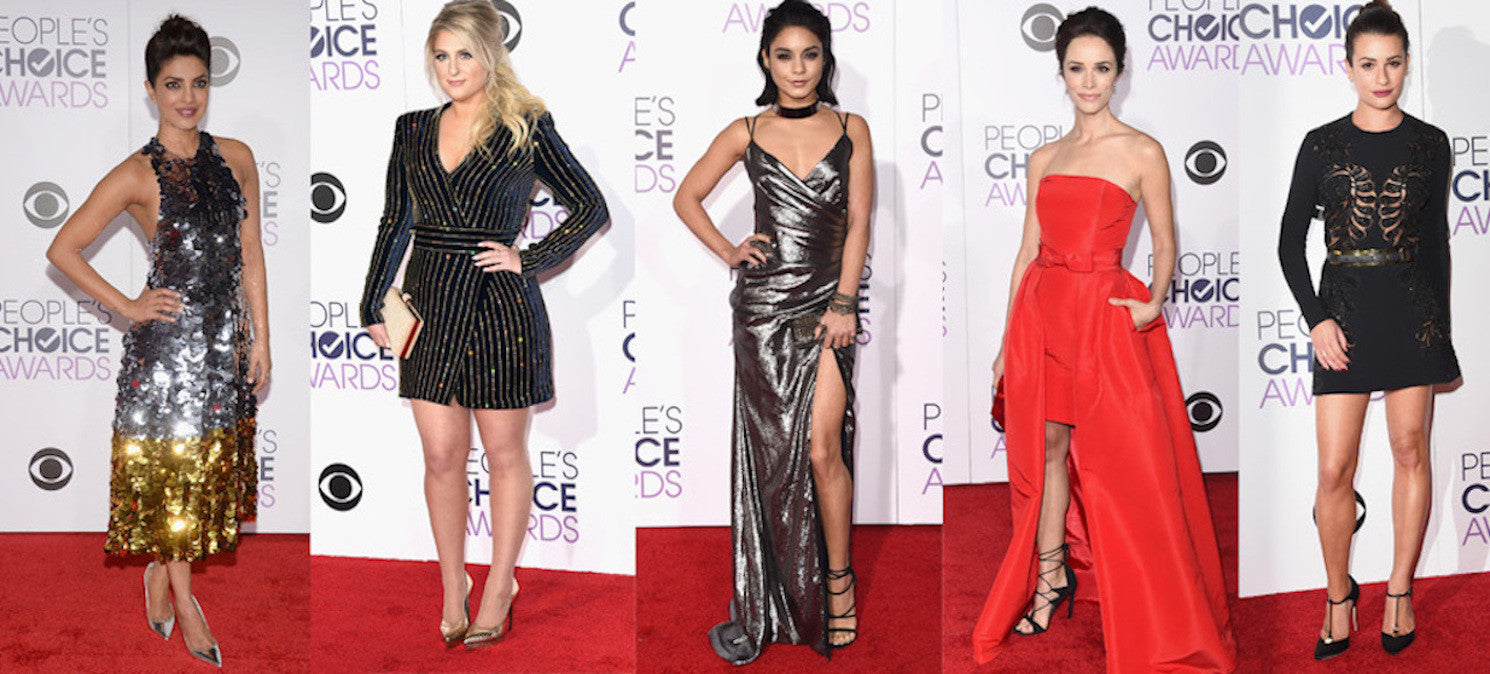 Five different celebrities all lined up on the red carpet.