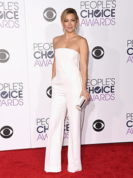Kate Hudson in a white hot Stella McCartney strapless jumpsuit.