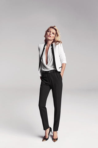 Kate Moss wearing a menswear-inspired look: black pants and a white blazer