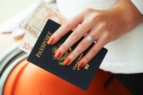 gorgeous long nails holding a passport