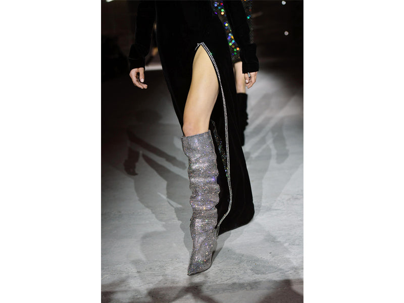 runway model wearing glamorous boots