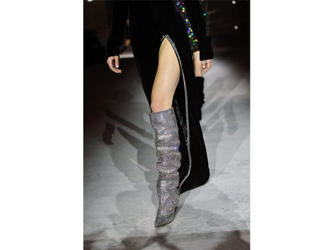 a runway model wearing sparkly boots