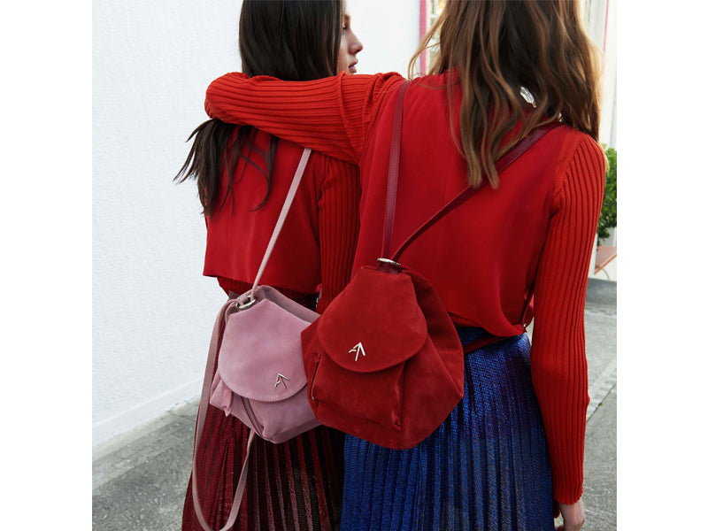 Two girls wearing trendy backpacks